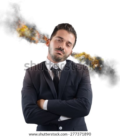 Businessman stressed out with ears in smoke - stock photo