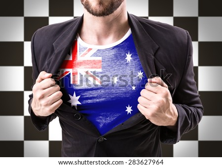 Businessman stretching suit with Australia Flag on checkered background - stock photo