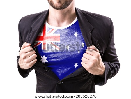 Businessman stretching suit with Australia Flag on white background - stock photo