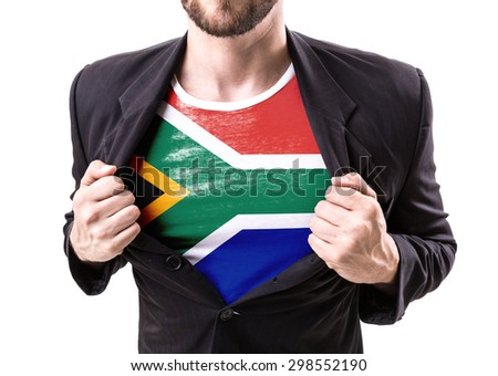 Businessman stretching suit with South African Flag isolated on white - stock photo