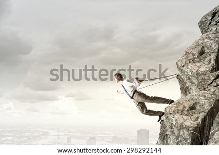 Businessman struggling with problems that occur on the way - stock photo