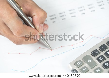 Businessman study financial report. Concept for business, finance, market research, analytics and statistics, marketing.