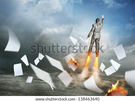Businessman Success. A businessman launching upwards, paperwork flying everywhere! - stock photo