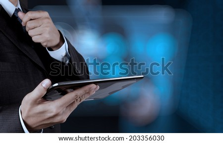 businessman success working computer touch screen with his team as concept  - stock photo