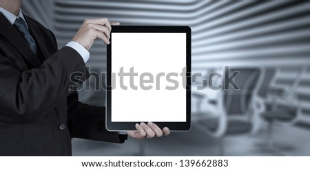 businessman success working with blank tablet computer his board room background as concept