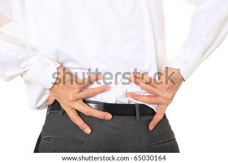 Businessman suffering from backache. All on white background - stock photo