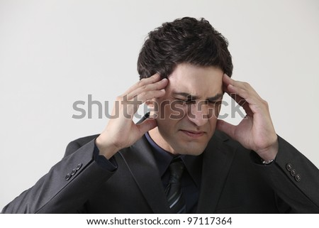 businessman suffering from stress and a headache