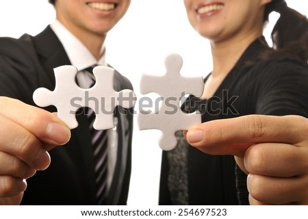 Businessman suffering to have a piece of jigsaw puzzle