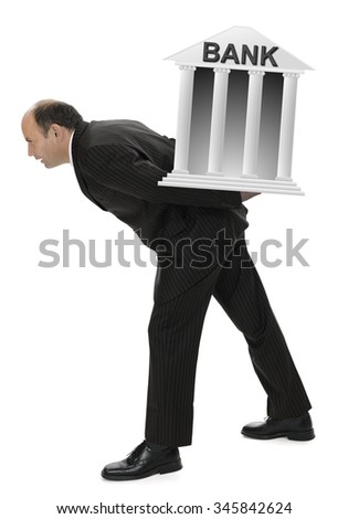 Businessman suffering under heavy financial bank burdens - stock photo