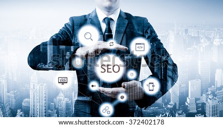 Businessman suggested effective 'SEO' optimisation approach. Hands presenting a 'SEO' flowchart - stock photo