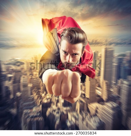 Businessman superhero flies faster in the sky - stock photo