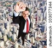Businessman superhero flying above a city - stock photo