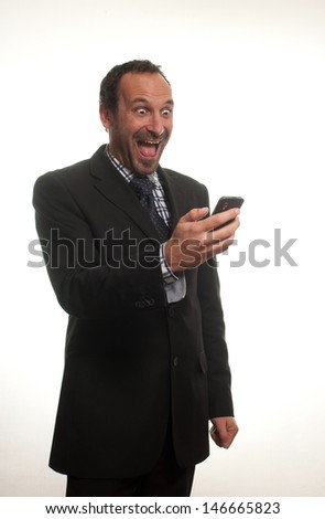 businessman surprised while reading a message
