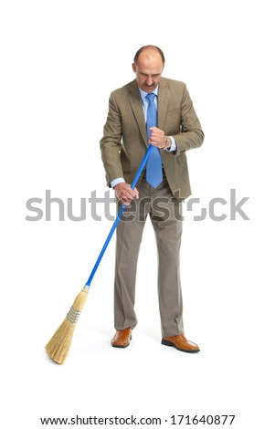 Businessman sweeps a floor on a white background