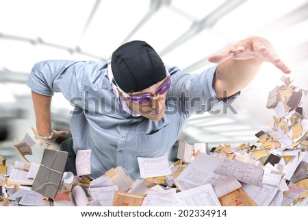Businessman swimming in a pool of papers - stock photo