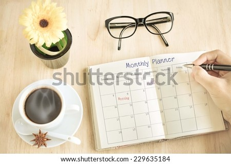 Businessman table Monthly planner  - stock photo