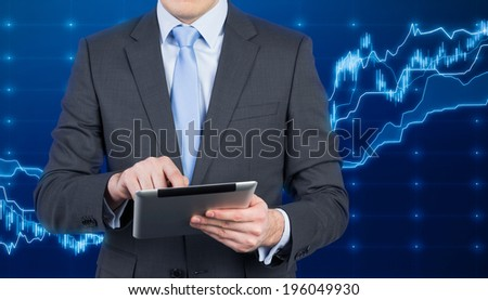 Businessman, Tablet and forex screen.  - stock photo