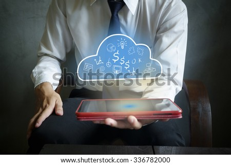 Businessman tablet holding cloud computing  in hand , business concept idea