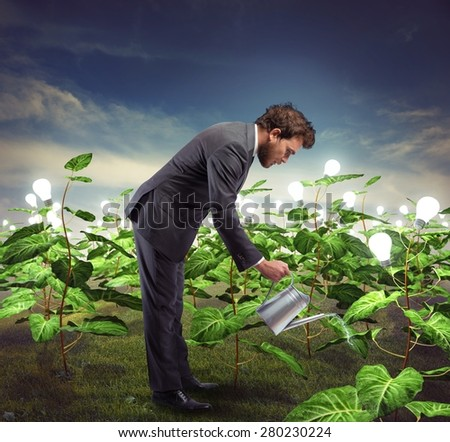Businessman take cares and nurtures new ideas - stock photo