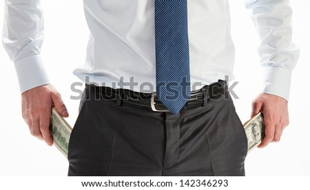 Businessman taking dollars out of pockets, closeup shot
