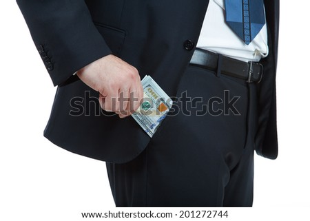 Businessman taking money from his trouser pocket against a white background. - stock photo
