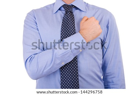 Businessman taking oath with fist over heart. - stock photo