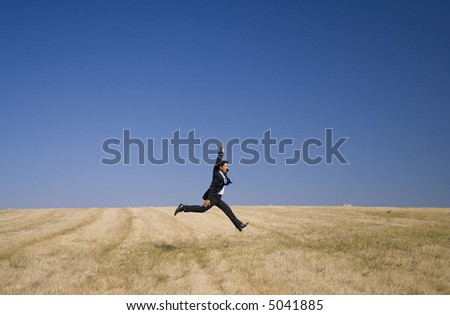 businessman taking the giant step, embracing nature - stock photo