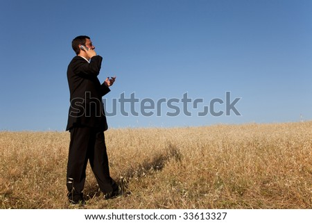 businessman talking at his cellular in the outdoor