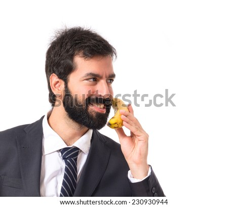 Businessman talking by banana over white background