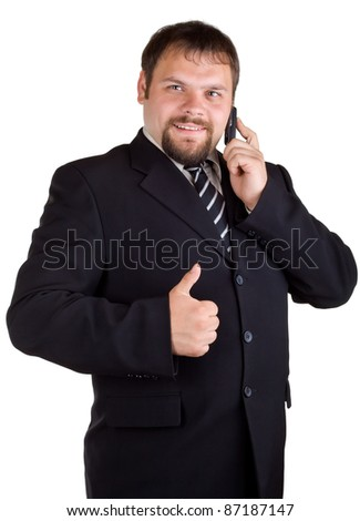 Businessman talking on a cell phone and shows up thumb, isolated on white