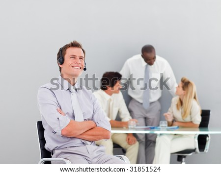 Businessman talking on a headset in an office