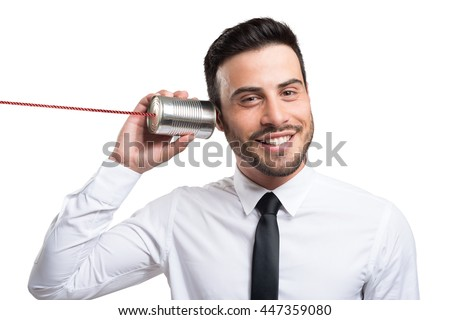 Businessman talking on a tin can phone