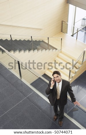 Businessman Talking on Cell Phone, elevated view