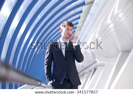 Businessman talking on the phone in modern building