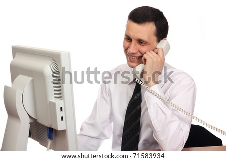 Businessman talking on the phone, looks at a monitor on a white background - stock photo