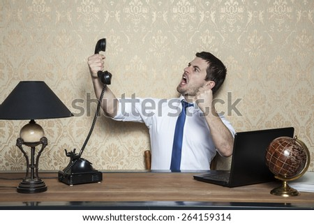 Businessman talking on the phone obnoxious customer - stock photo