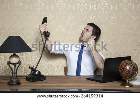 Businessman talking on the phone obnoxious customer - stock photo