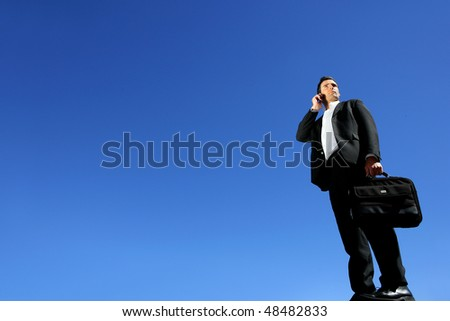 Businessman talking on the phone outside