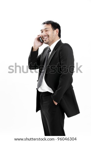 businessman talking to the phone and smiling.