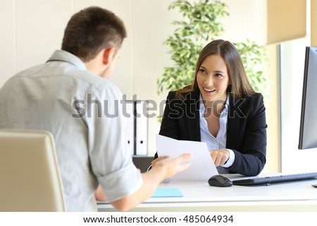 Businessman talking with his interviewer commenting his skills during a job interview