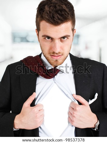 Businessman tearing his shirt like a superhero. You can add your own logo. - stock photo