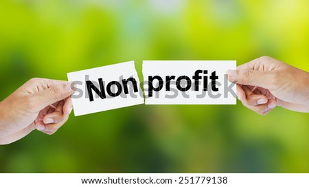 Businessman tearing the word Nonprofit for Profit - stock photo