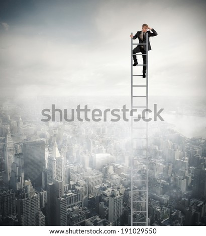 Businessman that looks far on a stair - stock photo