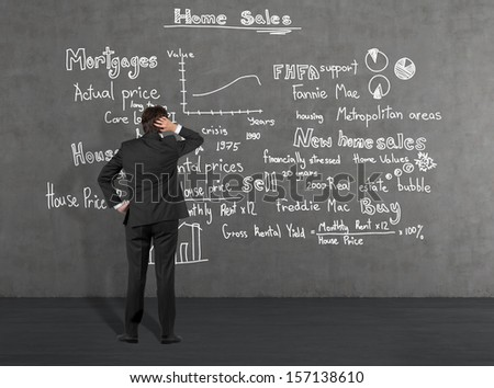 Businessman thinking about home sales 1