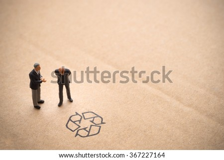 Businessman thinking about recycle idea with partner advice. - stock photo
