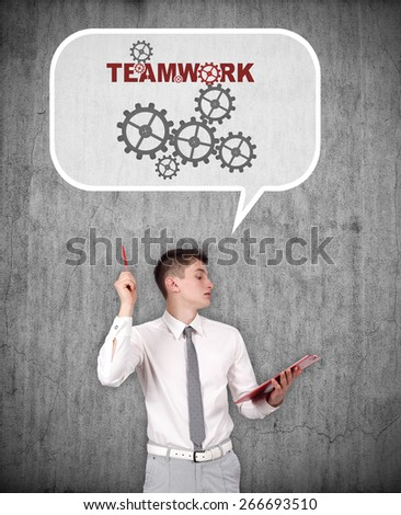 businessman thinking about teamwork on a gray background