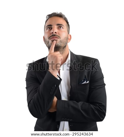 Businessman thinking about what decision to take - stock photo