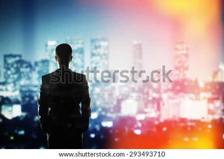 businessman thinking and looking to night city - stock photo