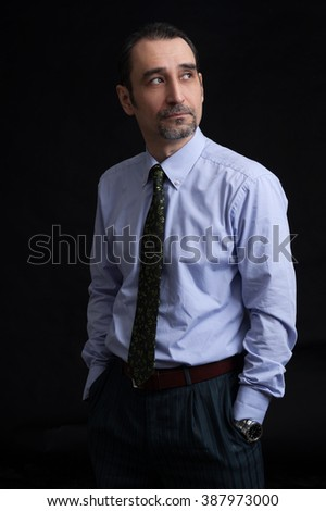 businessman thinking and looking up. Dark background