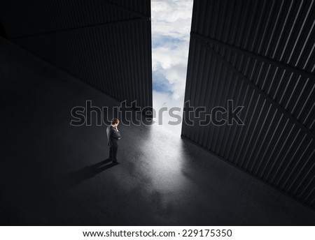 businessman thinking and open doors to sky - stock photo